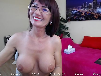 Suntanned Mature dam in eyeglasses teasing solo on webcam